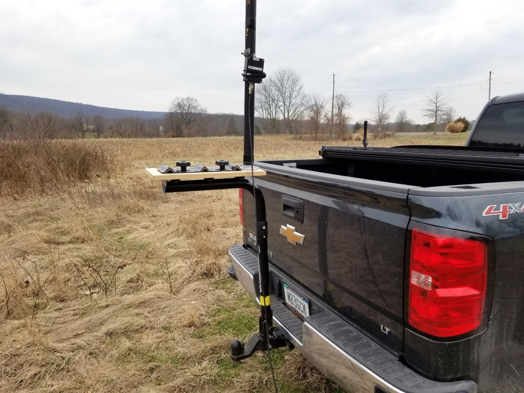 Bike Rack Antenna Mount. A 9:1 unun is attached to the Jackite pole with a bungee cord.