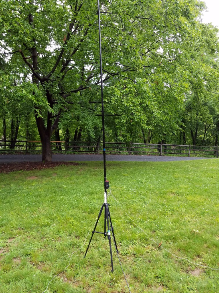 The antenna I was testing. The white piece between the telescopic pole and the tripod is an adapter I made from PVC pipe.
