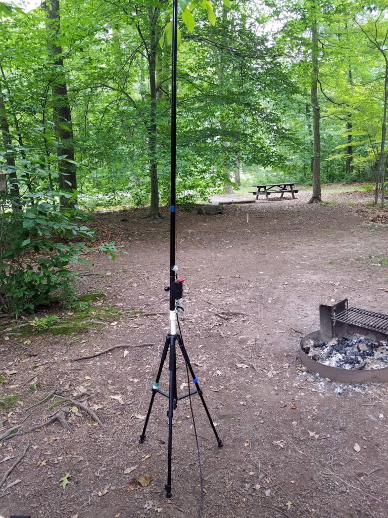 My experimental vertical antenna set up on our campsite for some quick SWR measurements.
