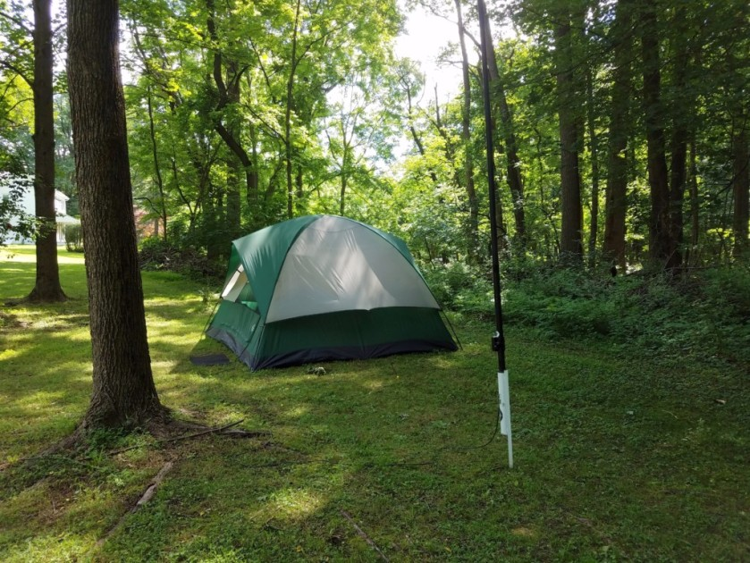 This is my (WB3GCK) tent. The Jackite pole in the foreground is supporting the vertical portion of my 58-ft inverted L antenna.