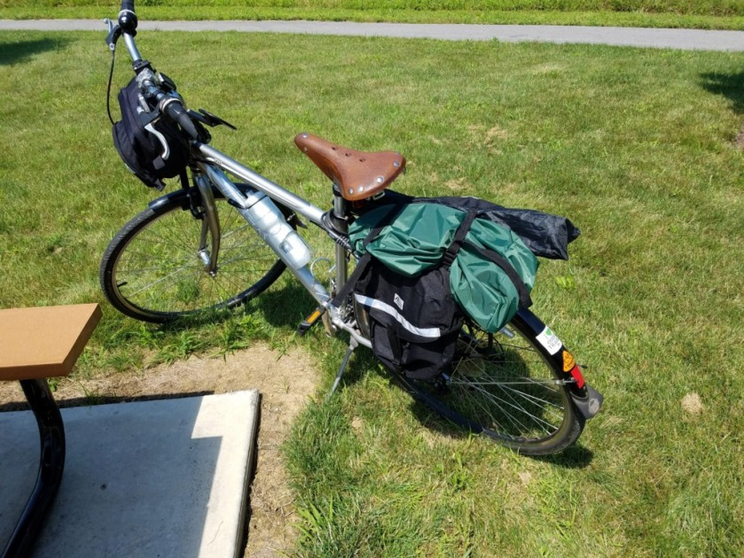 My bike loaded up and ready for travel. The AlexLoop structural components are in the green back. The coax radiator is in one of the pannier bags.