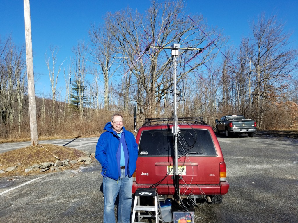 """Glen NK1N ready to work the """"birds"""" at High Point State Park. My truck with my vertical is in the background."""