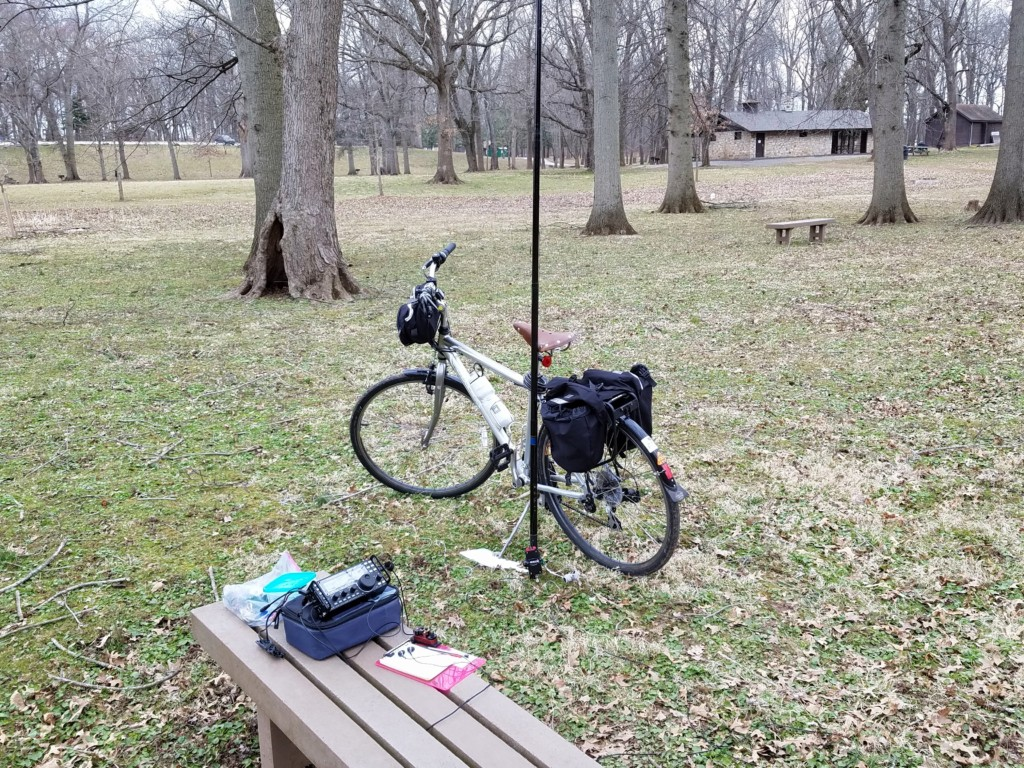 My setup in Lower Perkiomen Valley Park. The white object on the ground is a Dollar Store cutting board. The ground was soft so I used the cutting board under the kick stand to stabilize the bike.