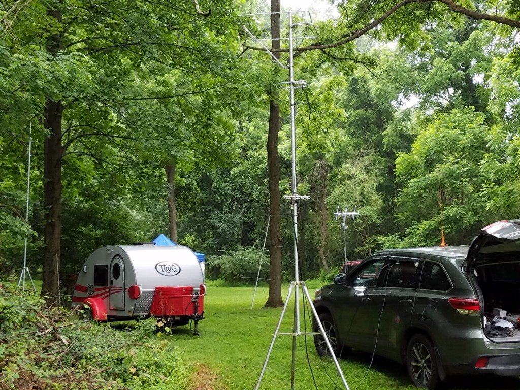 Part of the W3BQC Field Day site. Some of the VHF/UHF antennas are in the foreground. You can see the satellite antenna array in the background (above the car's hood).