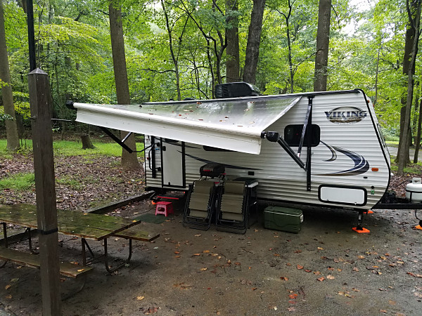 The WB3GCK camper on a rainy morning in Elk Neck State Park in Maryland. My Jackite pole is strapped to the lantern post on the left.
