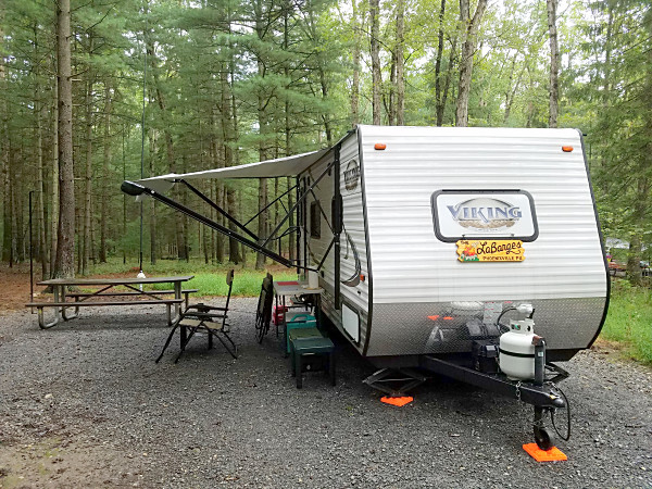 The WB3GCK QRP camper at Pine Grove Furnace State Park. If you look closely, you can see my antenna behind the picnic table. The white object is a plastic bag protecting the 9:1 unun from the rain we had on Friday night. The horizontal part of my inverted L runs back into the woods.
