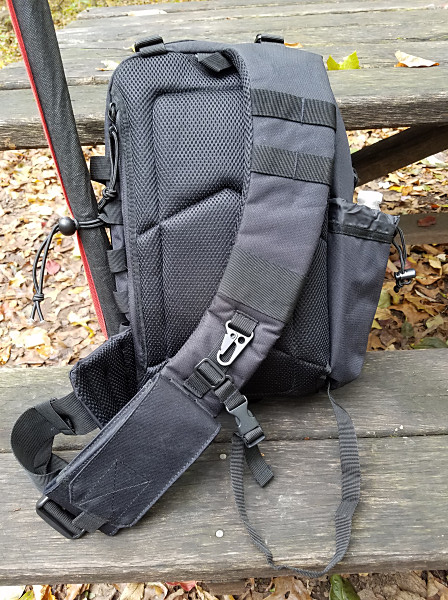 The back side of the Red Rock Rambler sling pack. There's a pouch behind the padded back of the pack that holds a folding sit pad. The small strap at the bottom of the picture helps to stabilize the pack but can be tucked away if not needed. My cell phone pouch is at the bottom of the shoulder strap.