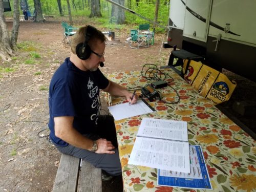Ron WA8YIH operating outside his camper at French Creek State Park