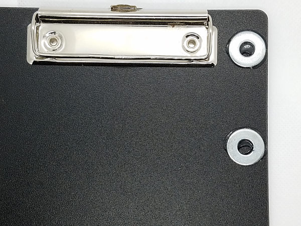 I used GOOP to attach the steel washers to the clipboards I use in the field. The washers are used to attach the magnet bases of my portable paddles and straight key.