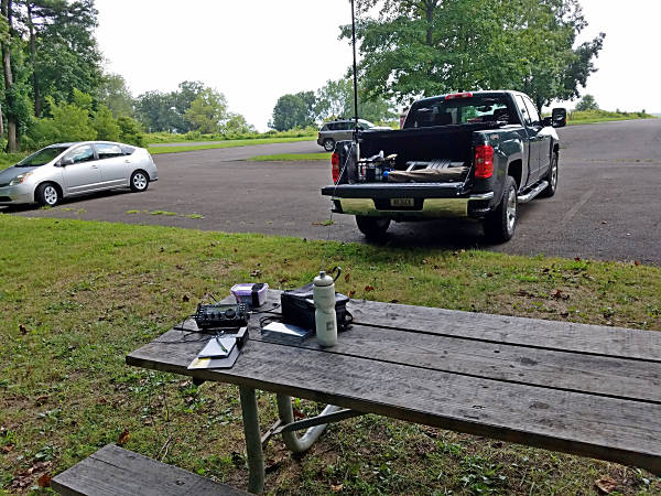 My set up in Valley Forge Park for the 2019 Skeeter Hunt. The table was well-shaded and close enough to the truck for 18-feet of coax to reach the antenna.