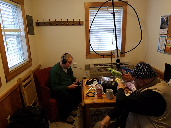 Ed K3YTR (L) trying his loop antenna inside the cabin with Ed K3BVQ observing