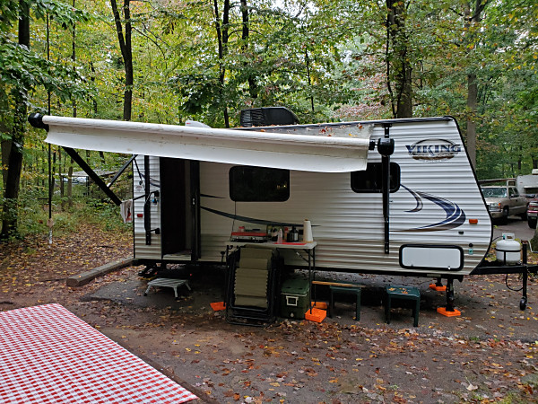 "The WB3GCK ""QRP Camper"" at French Creek State Park on a rainy Fall weekend. My antenna is on the left, behind the camper."
